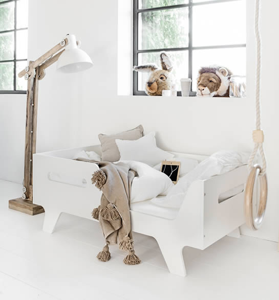 White wooden bed with storage box underneath